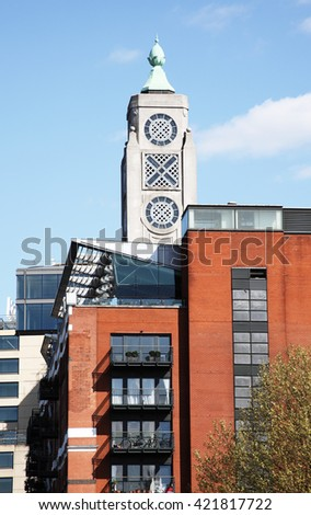 London, UK, April 13 2014 - The Oxo Tower stands at the side of The River Thames at Southwark over luxury apartments. It was originally constructed at the end of the 19th century as power station - stock photo