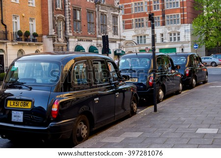 LONDON, UK - April 14, 2015: three London vintage cabs waiting in the street, UK - stock photo