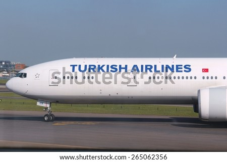 LONDON, UK - APRIL 16, 2014: Turkish Airlines Boeing 777 after landing at London Heathrow airport. As of 2014 Turkish Airlines flew to 261 destinations with fleet of 264 aircraft. - stock photo