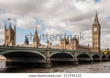 LONDON, UK - AUG 18: The Houses of Parliament, the Big Ben and Westminster Bridge in London on August 18, 2014 - stock photo