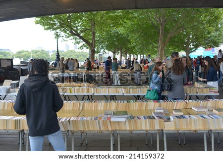 LONDON, UK - AUG 30, 2014: The Southbank Centre's Book Market is one of London's best kept secrets. Tucked under the Waterloo Bridge on Queen's Walk. - stock photo