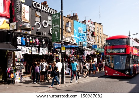 LONDON, UK - AUG 21: Tourists and locals walk in Camden Town, London on August 21, 2013. Camden Town is London's most popular open-air market area with stalls, shops, pubs and restaurants. - stock photo