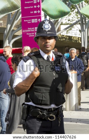 LONDON, UK - AUGUST 5: A London policeman on duty outside Stratford train and metro station on August 5, 2012 in London UK. - stock photo