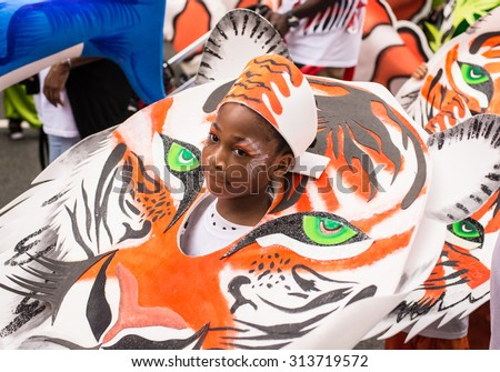 London, UK - 30 August 2015: Boy wearing a tiger costume during the street parade for the Notting Hill Carnival, one of the biggest street festival in Europe