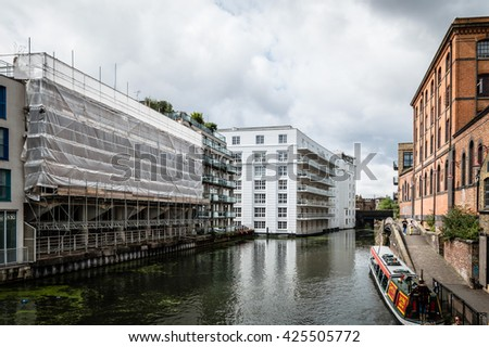 LONDON, UK - AUGUST 20, 2015: Regent Canal near Camden Town Market, famous alternative culture shops. Cloudy day