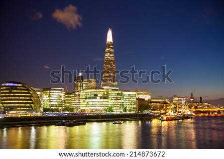 LONDON, UK - AUGUST 11, 2014: Shard of glass in night lights, view from the Tower bridge - stock photo
