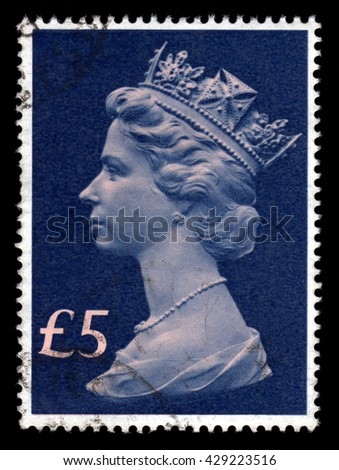 London, UK, August 1 2009 - Vintage blue Queen Elizabeth II five pounds Great Britain postage stamp - stock photo