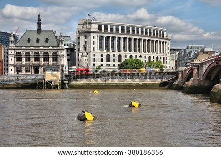 London, UK - Blackfriars area with City of London School (left). River Thames with yellow mooring buoys. - stock photo