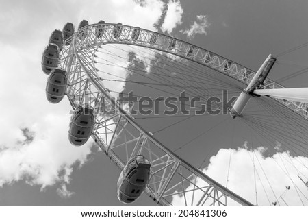 LONDON, UK / CIRCA JULY 2014 - The famous London Eye, one of London's most iconic landmarks on a bright summer day - stock photo