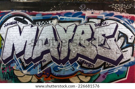 LONDON, UK / CIRCA OCTOBER 2014 - 'MAYBE' graffiti made by unknown artist seen on Leake Street public gallery  - stock photo