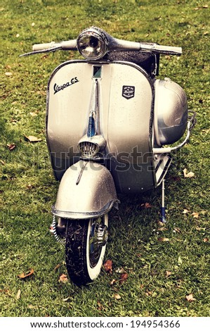 LONDON, UK - CIRCA SEPTEMBER 2011: A Vespa GS scooter after the rain. - stock photo