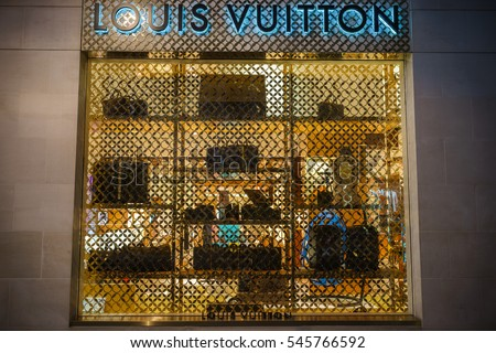 LONDON, UK - DECEMBER 12, 2016: A close-up of a Louis Vuitton symbol and shop display at their store on New Bond Street in London