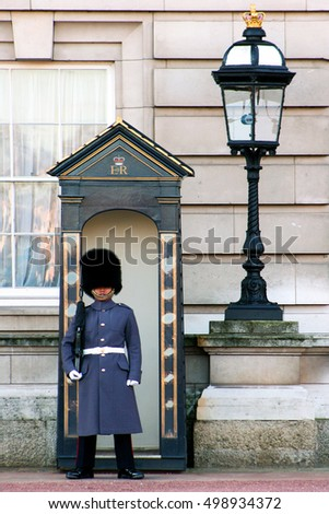LONDON, UK - December 26, 2005: British Royal guard at the Buckingham Palace  on guard duty in London. This is also a great tourist atraction.