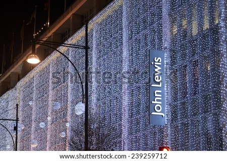 LONDON, UK - DECEMBER 20: Nighttime shot of John Lewis department store with its wall of light as part of its Christmas decoration. December 20, 2014 in London. - stock photo