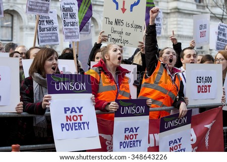 LONDON, UK - DECEMBER 2, 2015: Unidentified student nurses protesting outside Department of Health in Whitehall against the Government's axing of student nurses' bursaries.