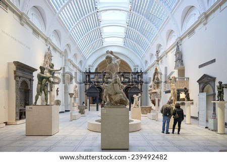LONDON, UK - DECEMBER 20: Victoria and Albert museum's Medieval and Renaissance room, with statue of Samson slaying a Philistine in the centre. December 20, 2014 in London. - stock photo