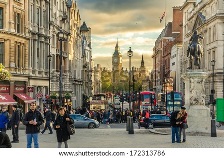 London, UK - December 6, 2013: View of Whitehall crowed with Tourist and Commuters at Sunset. Whitehall is a Street in the City of Westminster lined with government departments and ministries. - stock photo