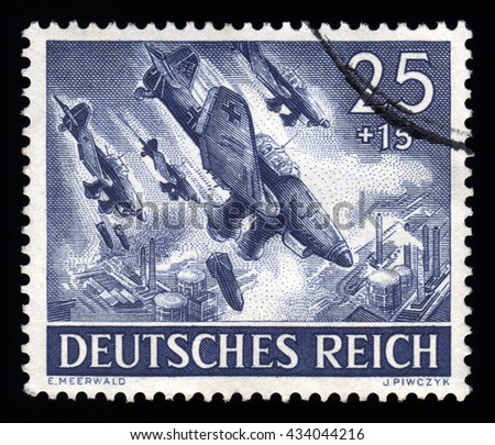 London, UK, December 30 2010 - Vintage 1943 German cancelled postage stamp showing an image of a World War Two Third Reich Luftwaffe Stuka's dive bombing an oil depot - stock photo