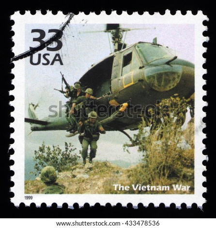 London, UK, December 7 2010 - Vintage 1999 United States of America cancelled postage stamp with 1960's Vietnam War USA soldier marines entering battle from a helicopter - stock photo