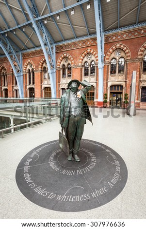 LONDON, UK - 24 FEBRUARY 2011: A wide angle portrait of the statue of Sir John Betjement, the English poet, located in the concourse of St. Pancras train station, London. - stock photo