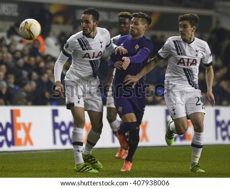 LONDON, UK - FEBRUARY 25, 2016: Mauro Zarate of Fiorentina pictured between two opponents during the UEFA Europa League last 32 game between Tottenham Hotspur and AC Fiorentina on White Hart Lane. - stock photo