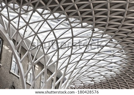 LONDON, UK - FEBRUARY 26, 2014: The ceiling in the refurbished section of Kings Cross Station in London, modernised at the time of the 2012 Olympic Games. - stock photo