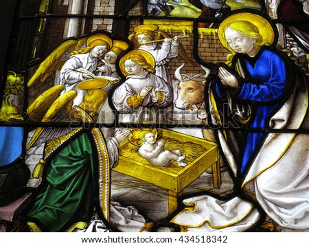 London, UK, February  21 2010 - The Nativity showing the birth of Christ  in an image on a medieval 16th century stained glass window from the Abbey of Mariawald - stock photo