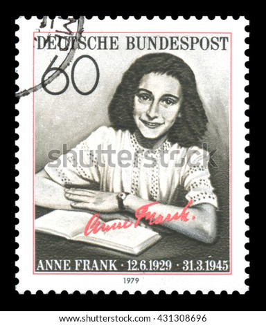 London, UK, February 3 2012 - Vintage 1979 Germany cancelled postage stamp showing an image  of Anne Frank who as a young girl was a victim of the Holocaust, later to become famous for her diary - stock photo