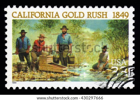 London, UK, February 5 2011 - Vintage 1999 United States of America cancelled postage stamp  showing an image of California Gold Rush miners panning for gold - stock photo