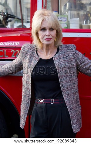 LONDON, UK - January 5 Actress Joanna Lumley poses in front of a Red London double decker in Trafalger Square London on the January 5, 2012 in London, UK