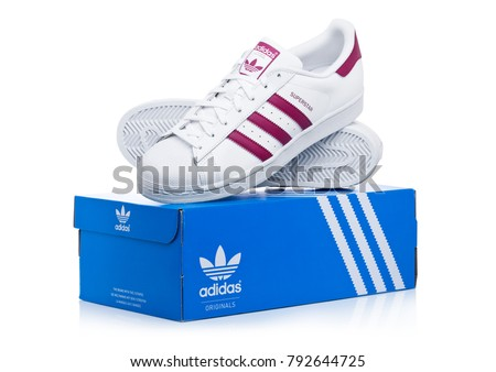 LONDON, UK - JANUARY 12, 2018: Adidas Originals Superstar red shoes with box