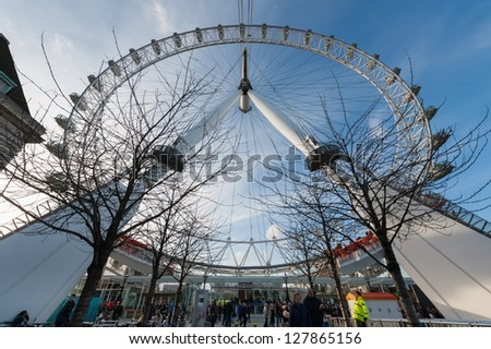 LONDON, UK -JANUARY 27:  As of 2013, over 5000 marriage proposals have been made on the London Eye tourist attraction near the River Thames in London, UK on January 27, 2013 - stock photo