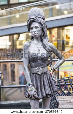 LONDON, UK - JANUARY 29: Bronze statue of late singer Amy Winehouse in Camden Lock Market, Camden Town, on January 29, 2016 in London. - stock photo
