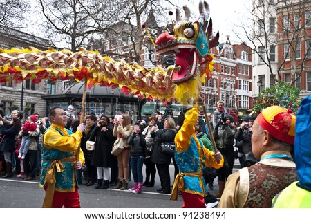 LONDON, UK-JANUARY 29: Chinese Dragon dancers take to the streets in a parade, part of the famous London celebrations for the year of the dragon, January 29, 2012 in London UK