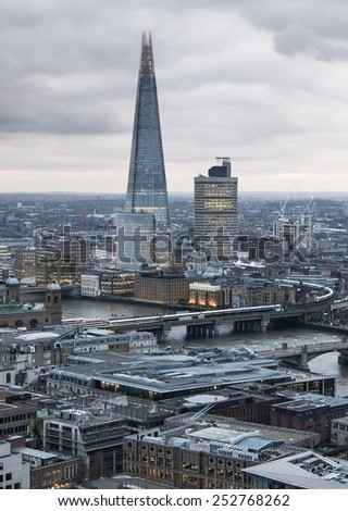 LONDON, UK - JANUARY 27, 2015: Shard. City of London, business and banking aria. London's panorama in sun set. View from the St. Paul cathedral - stock photo