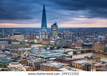 LONDON, UK - JANUARY 27, 2015: Shard of glass building. City of London, business and banking aria. London's panorama in sun set. View from the St. Paul  - stock photo
