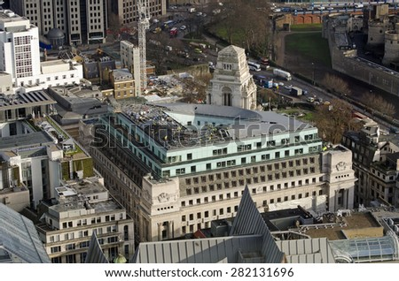 LONDON, UK - JANUARY 4, 2015:  The old Port of London Authority Building on Tower Hill in the City of London.  The historic landmark on Trinity Square is now being converted to a luxury hotel. - stock photo