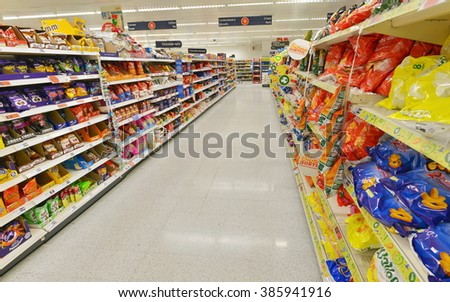 LONDON, UK - JUL 3, 2014: A general view of an aisle in a Sainsbury's supermarket. Sainsbury's is the UK's 2nd largest supermarket with a revenue of GBP 23 billion in 2013. - stock photo