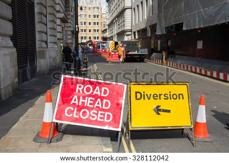 LONDON, UK - JUL 2, 2015: Road Ahead Closed and Diversion signs in a street of London during construction work.