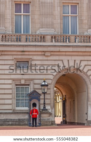 LONDON, UK - JULY 11, 2012: A guard on duty, outside his sentry box, at Buckingham Palace in London, England.