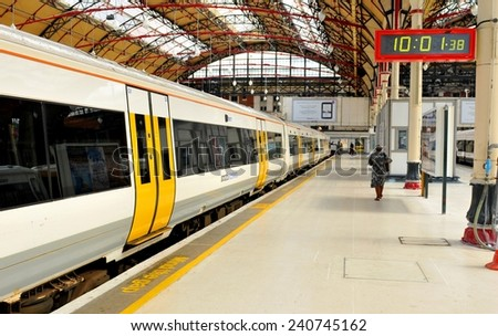 LONDON, UK - JULY 9, 2014: A South Eastern train leaves the platform in Victoria train station.  - stock photo
