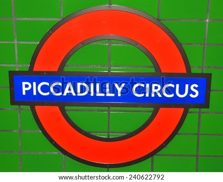 LONDON, UK - JULY 9, 2014: Abstract detail of London Piccadilly Circus underground sign against white tiles. - stock photo