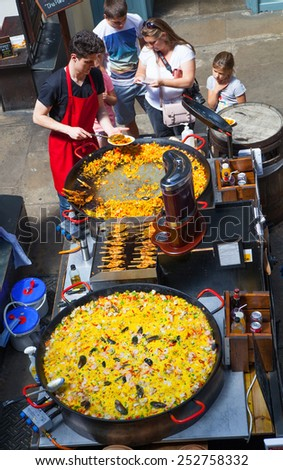LONDON, UK - 22 JULY, 2014: Big Paella Covent Garden market, one of the main tourist attractions in London, known as restaurants, pubs, market stalls, shops and public entertaining. - stock photo
