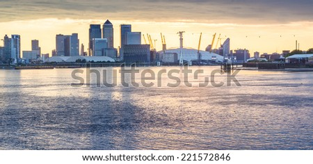 LONDON, UK - JULY 26 2014: Canary Wharf and o2 arena in  London UK - stock photo