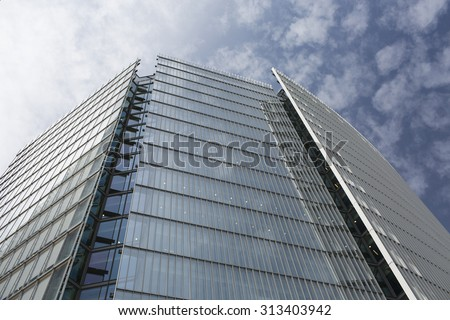 LONDON, UK - JULY 22, 2015 - Corner of News UK headquarters in London next to London Bridge station in England - stock photo
