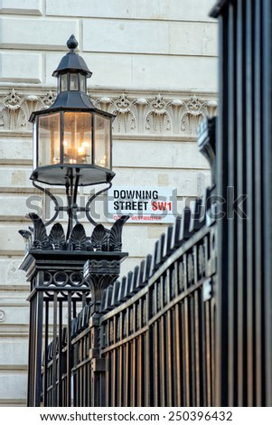 LONDON, UK - JULY 1, 2014: Downing Street's sign in the City of Westminster. Downing St. has housed government leaders for over three hundred years. - stock photo