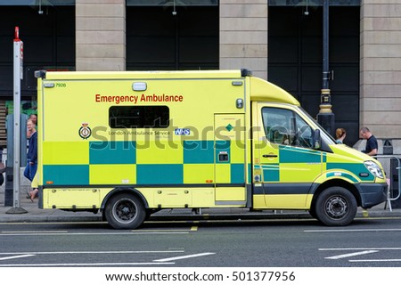 LONDON, UK - JULY 8, 2016: Emergency Ambulance speeds along street in London in response to an emergency call