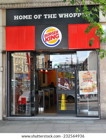 LONDON, UK - JULY 9, 2014: Entrance to a Burger King fast food restaurant in central London.  - stock photo