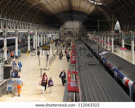 LONDON, UK - JULY 19: Interior of Paddington train station on July 19, 2012, London, UK. Train station has recently been modernized, it's terminal for the dedicated Heathrow Express airport service. - stock photo