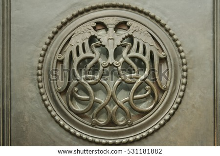 London, UK - July 28, 2007: interlocking serpents forming decorative grill on door Bank of England Threadneedle St London, The Bank of England is the central bank of the UK